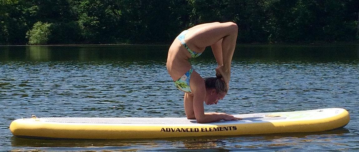 Amabassador Yoga Lindsey practicing on her Lotus YSUP